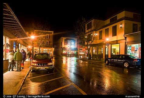 Picture/Photo: Street at night with people standing on