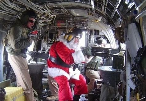 Funny Gun Related Christmas Pictures with Santa
